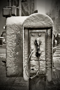 Payphone encased in snow