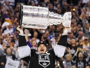LA Kings captain Dustin Brown hoisting the Stanley Cup